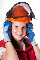 A girl wearing ear protection.