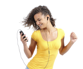 young woman with audio device wearing earbuds and dancing