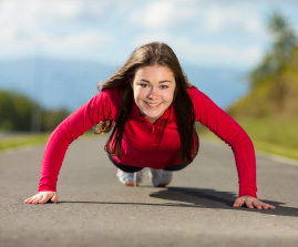 young woman in push-up position