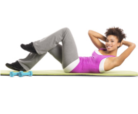 young woman doing stomach crunch on a mat