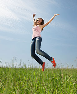 A girl jumping up to the sky.
