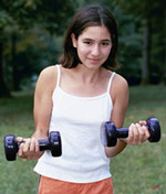 Girl holding two barbells