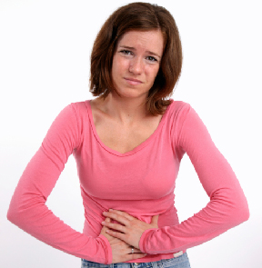 Photo of a teenage girl with a stomach ache.