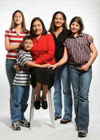A family of four women and a young boy.