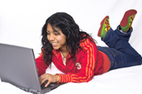 A girl using her laptop.